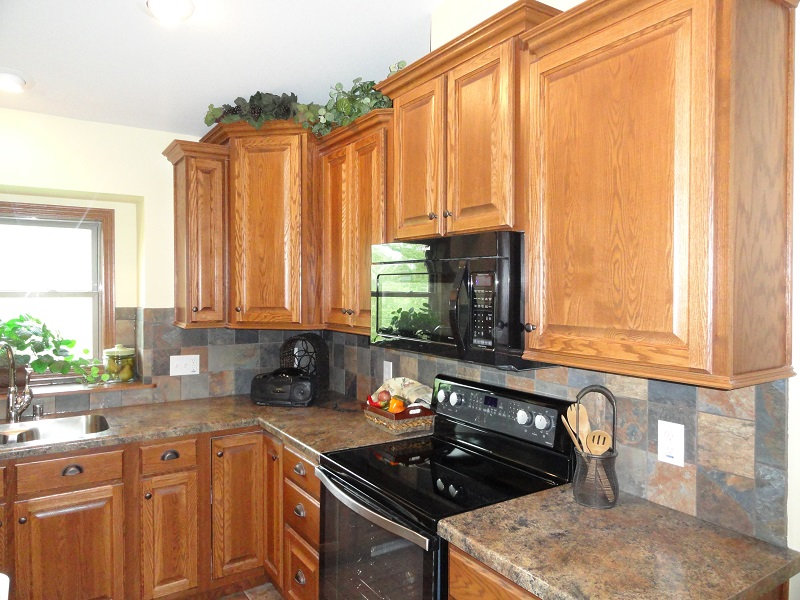 Amity creek homes services for Oak crown molding for kitchen cabinets